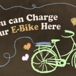 Charging Electric Bike with Love. Illustration about Freedom and Simple Living